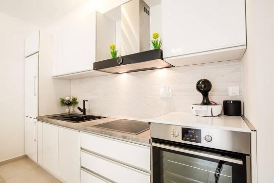 Новейшая бытовая техника и аппаратура на кухне апартаментах